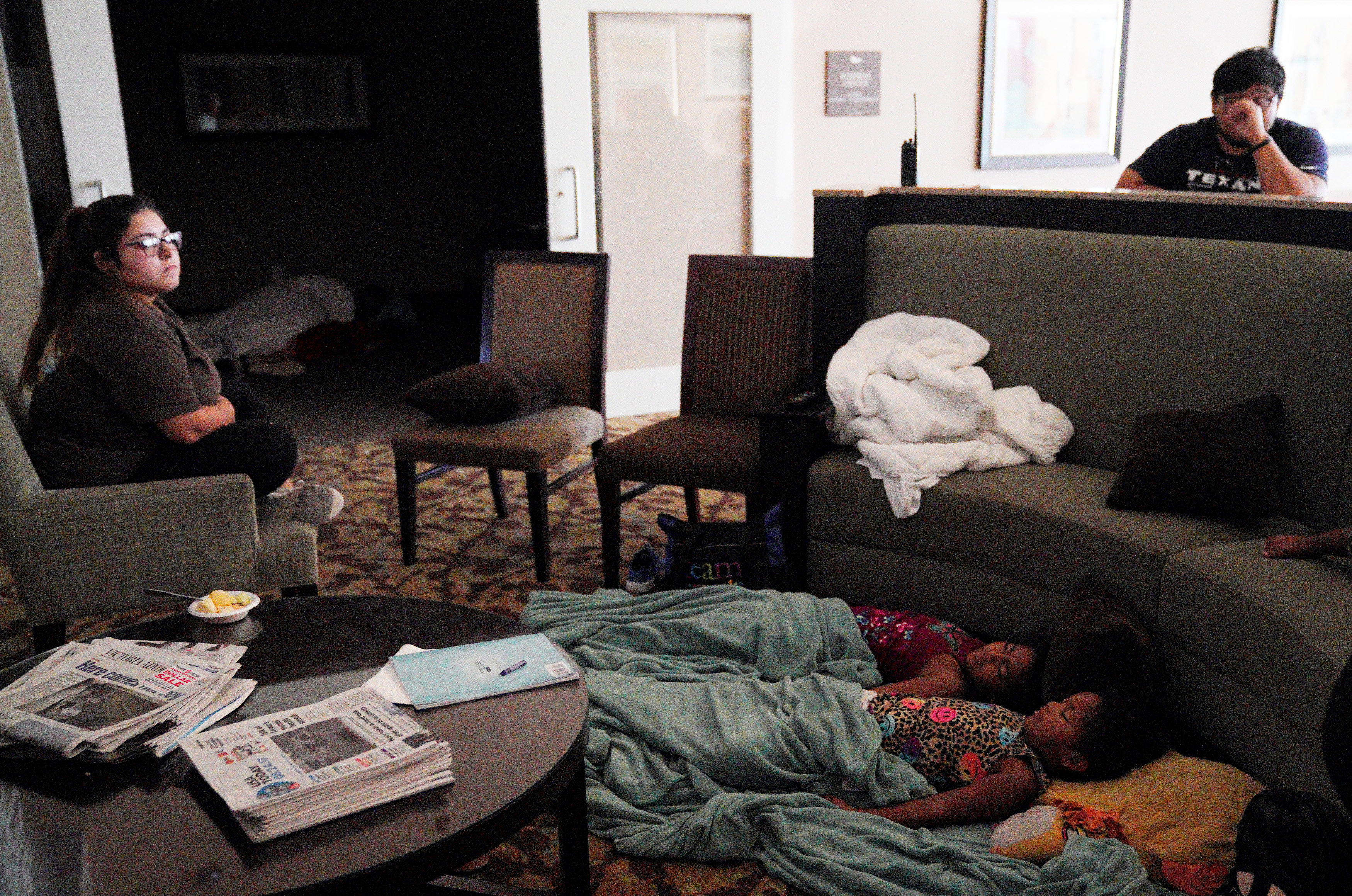 Children sleep in a hotel lobby waiting out Hurricane Harvey in Victoria, Texas on Aug. 26, 2017. (REUTERS/Rick Wilking)