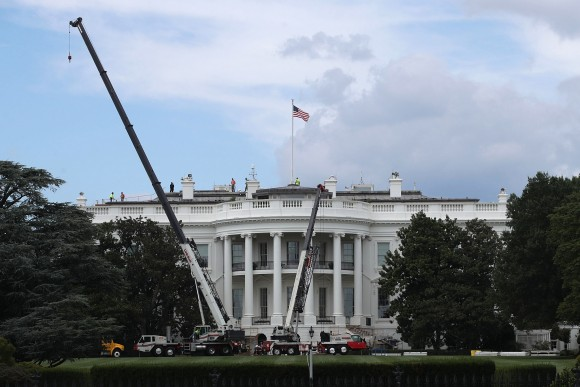 Cranes are seen on the South Lawn of the White House Aug. 8, 2017 in Washington, DC. The White House is underwent a major renovation while President Donald Trump stayed in Bedminster, New Jersey, with an upgrade of the HVAC system at the West Wing, the South Portico steps, the Navy mess kitchen, and the lower lobby. (Alex Wong/Getty Images)