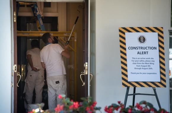 Workers are seen painting inside a West Wing entrance of the White House on Aug. 9, 2017. (MANDEL NGAN/AFP/Getty Images)