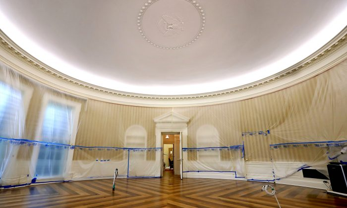 The Oval Office sits empty and the walls covered with plastic sheeting during renovation work at the White House on Aug. 11, 2017. (Chip Somodevilla/Getty Images)
