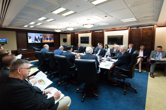 President Donald Trump is seen on screen in the White House Situation Room, as he conducts a video teleconference regarding an update on Hurricane Harvey, from a conference room at Camp David, on Aug. 26, 2017. (Official White House Photo by Andrea Hanks)