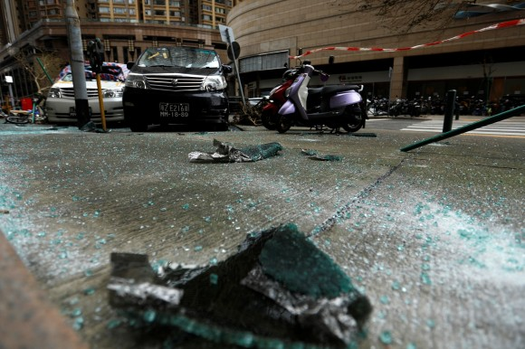 Debris from a piece of glass whcih fell from an apartment is seen as Tropical storm Pakhar hits Macau, China August 27, 2017. (Reuters/Tyrone Siu)