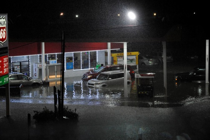 Cars sit abandoned at a flooded gas station after Hurricane Harvey made landfall on the Texas Gulf coast and brought heavy rain to the region, in Houston, Texas, U.S. on Aug. 26, 2017.  (REUTERS/Nick Oxford)