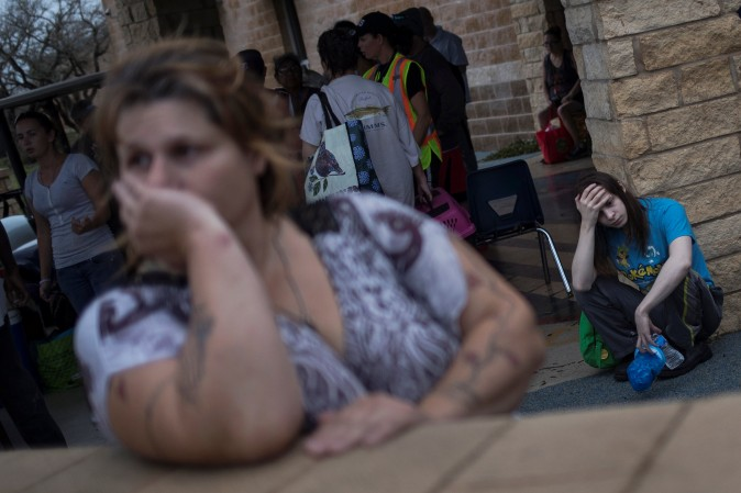 Melanie Starnauld and her 19-year-old son Mathew, who lost their home to Hurricane Harvey, await to be evacuated from Rockport, Texas, U.S. on Aug.t 26, 2017.  (REUTERS/Adrees Latif)
