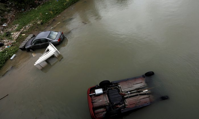 Vehicles are seen broken down and bring blown into sea by Typhoon Hato as Tropical storm Pakhar hits Macau, China on Aug. 27, 2017. (REUTERS/Tyrone Siu)