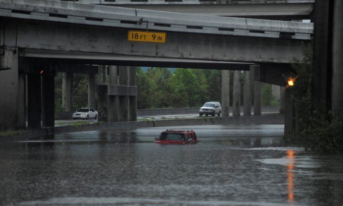 An abandoned Hummer is covered in floodwaters on Interstate 610 after Hurricane Harvey inundated the Texas Gulf coast with rain, in Houston, Texas, U.S. on Aug. 27, 2017.  (REUTERS/Nick Oxford)