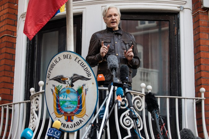 Julian Assange speaks to the media from the balcony of the Embassy Of Ecuador in London on May 19. (Jack Taylor/Getty Images)