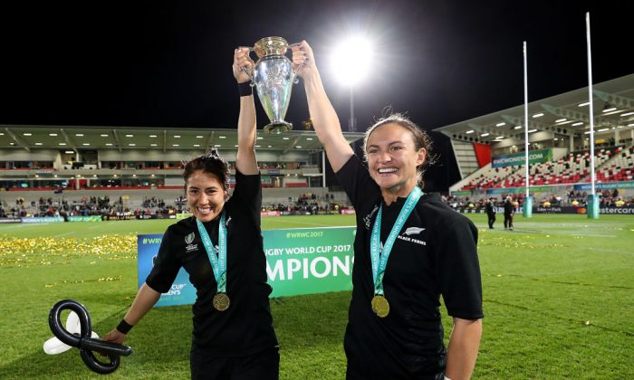Lesley Ketu (L) and Kristina Sue (R) of New Zealand celebrate with the trophy following the Women's Rugby World Cup 2017 Final between England and New Zealand on August 26, 2017 in Belfast, United Kingdom. (David Rogers/Getty Images)