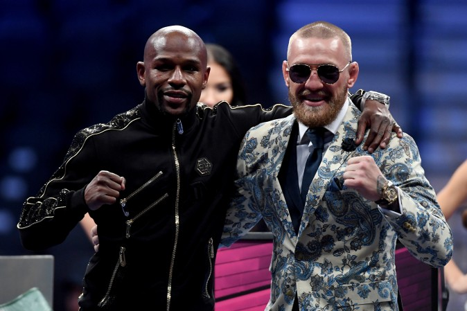 (L-R) Floyd Mayweather Jr. and Conor McGregor pose for pictures after Mayweather's 10th round TKO victory in their super welterweight boxing match at T-Mobile Arena in Las Vegas, Nevada on Aug. 26, 2017. (Ethan Miller/Getty Images)