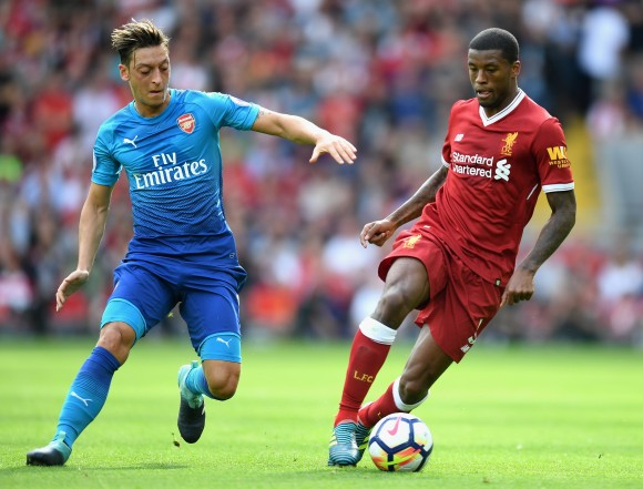 Mesut Ozil of Arsenal and Georginio Wijnaldum of Liverpool battle for possession during the Premier League match between Liverpool and Arsenal at Anfield on August 27, 2017 in Liverpool, England. (Michael Regan/Getty Images)