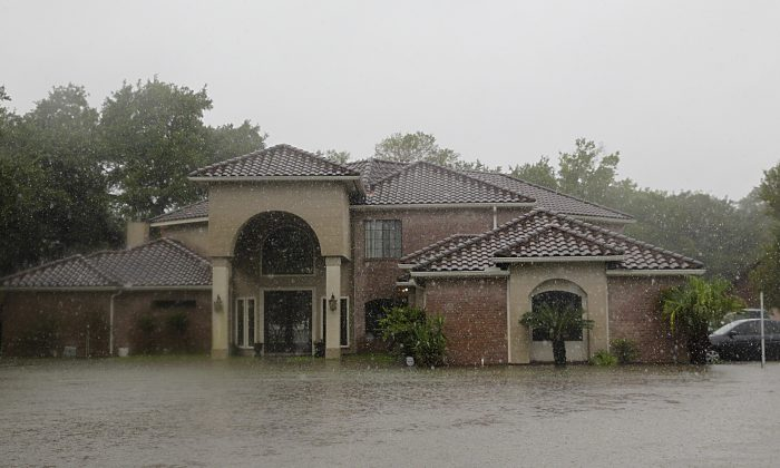 A house is flooded in east Pearland, on August 27, 2017 as the US fourth city city battles with tropical storm Harvey and resulting floods. (THOMAS B. SHEA/AFP/Getty Images)