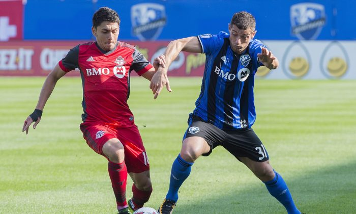 Montreal Impact's Blerim Dzemaili (R) challenges Toronto FC's Marky Delgado at Stade Saputo in Montreal on Aug. 27, 2017. TFC extended its unbeaten streak to nine games with the important win on the road. (The Canadian Press/Graham Hughes)