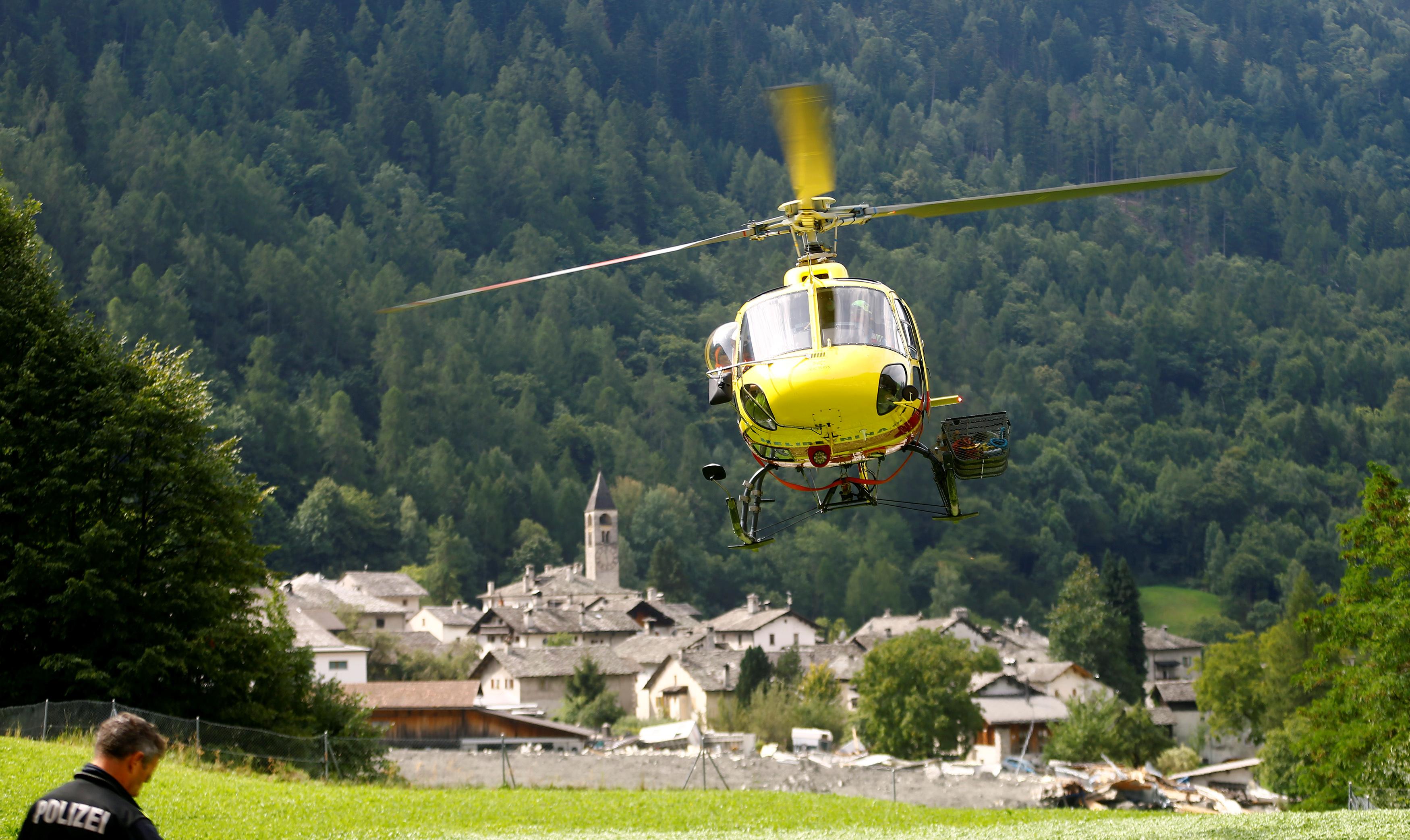 A helicopter of HeliBernina takes off nearby the village of Bondo in Switzerland, on Aug. 26, 2017. (REUTERS/Arnd Wiegmann)