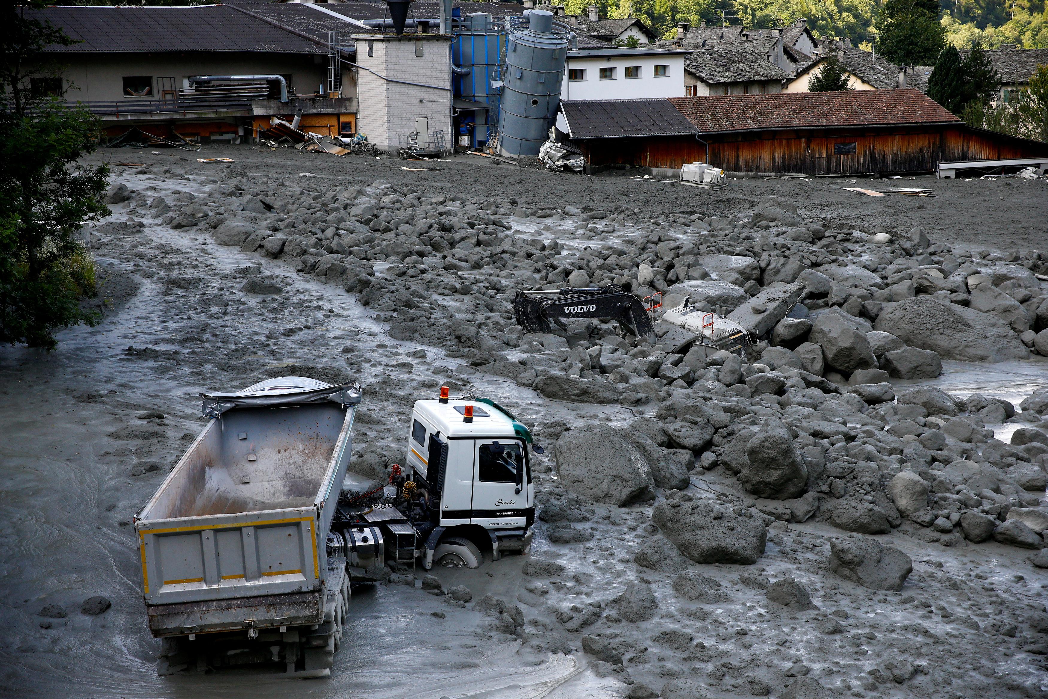 A truck sits in a landslide in the village of Bondo in Switzerland, on Aug. 26, 2017. (REUTERS/Arnd Wiegmann)