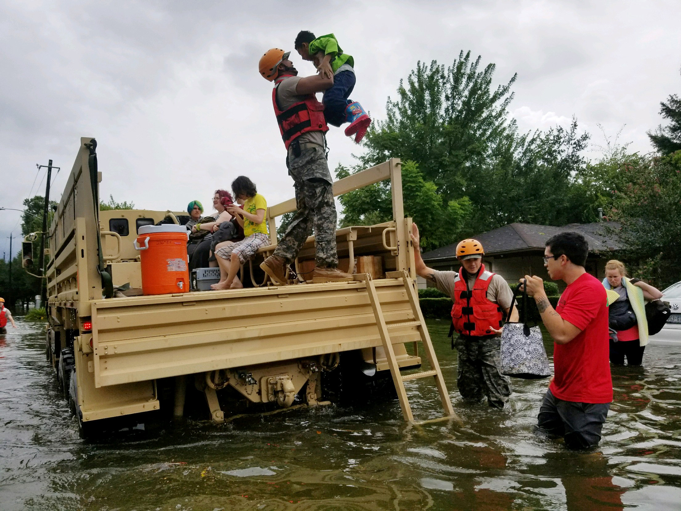 Texas National Guard soldiers aid residents in heavily flooded areas from the storms of Hurricane Harvey in Houston, Texas, U.S. on Aug. 27, 2017 (100th MPAD/Texas Military Department/Handout via REUTERS)