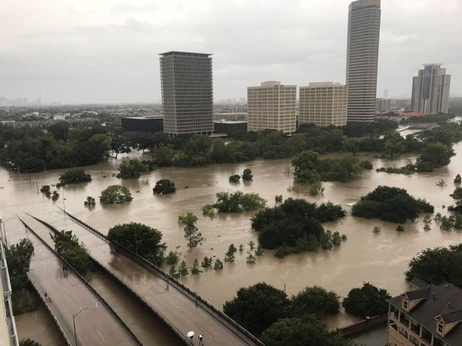 Flooded downtown is seen from a high rise along Buffalo Bayou after Hurricane Harvey inundated the Texas Gulf coast with rain causing widespread flooding, in Houston, Texas, U.S. on Aug. 27, 2017. (Twitter/@caroleenarn via REUTERS)