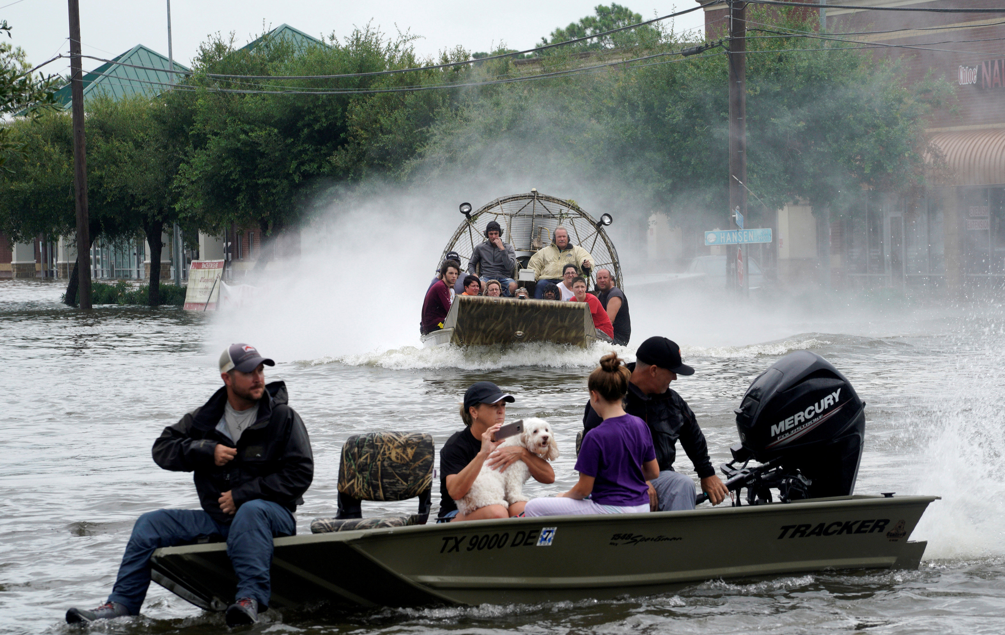 People are rescued from flood waters from Hurricane Harvey on an air boat in Dickinson, Texas on Aug. 27, 2017. (REUTERS/Rick Wilking)