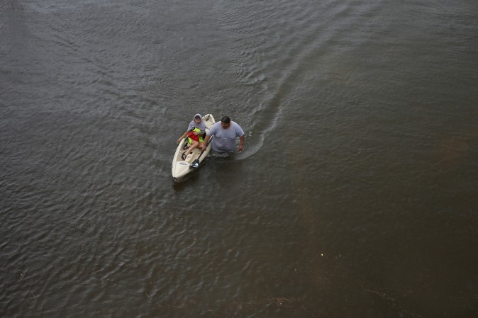 Jesus Rodriguez rescues Gloria Garcia in Pearland, in the outskirts of Houston.  (REUTERS/Adrees Latif)