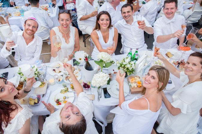 Guests attend the annual Diner en Blanc at Lincoln Center in New York on Aug. 22, 2017. Diner en Blanc began in France nearly 30 years ago. (Eric Vitale for Diner en Blanc)