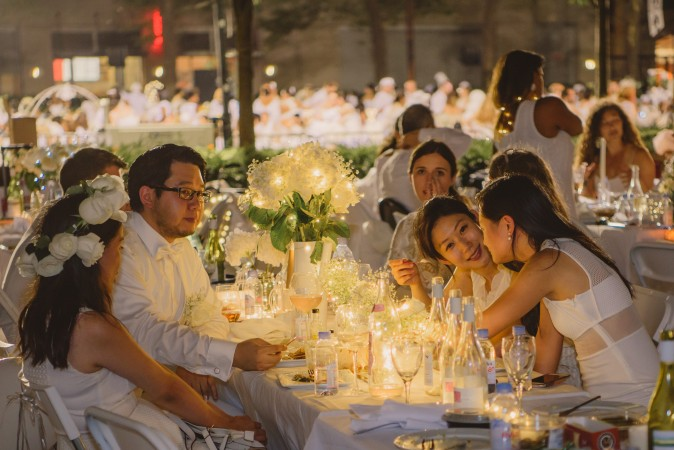 Guests attend the annual Diner en Blanc at Lincoln Center in New York on Aug. 22, 2017. Diner en Blanc began in France nearly 30 years ago and is held around the world. (Light Feather for Diner en Blanc)
