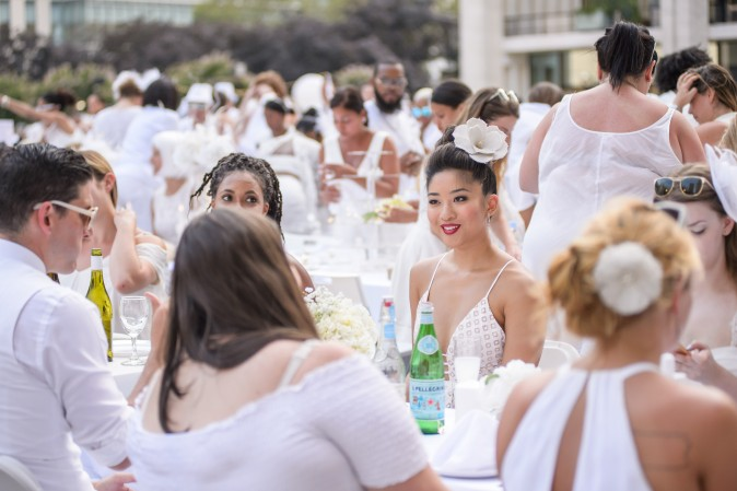 Guests attend the annual Diner en Blanc at Lincoln Center in New York on Aug. 22, 2017. Diner en Blanc began in France nearly 30 years ago and is held around the world. (Jane Kratochvil for Diner en Blank)
