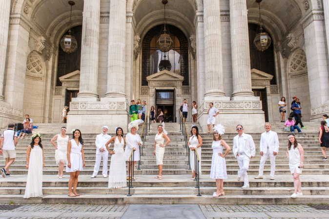 Attendees of Diner en Blanc meet at the New York Public Library before heading to the Lincoln Center for annual event on Aug. 22, 2017. (Jane Kratochvil for Diner en Blank)