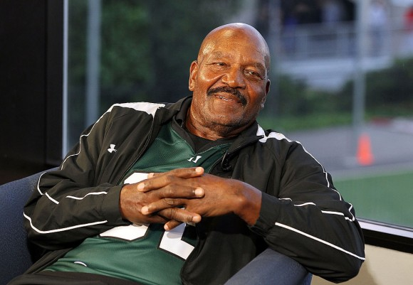 Football legend  Jim Brown conducts an interview before a Major League Lacrosse game against the Ohio Machine on June 1, 2012 at Shuart Stadium in Uniondale, New York.  (Photo by Jim McIsaac/Getty Images)