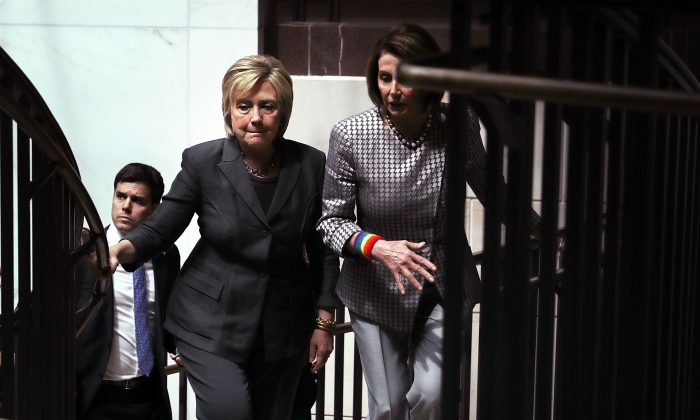 Accompanied by House Minority Leader Rep. Nancy Pelosi (D-CA) (R),  Hillary Clinton leaves after she met with House Democrats on Capitol Hill in Washington on June 22, 2016. (Alex Wong/Getty Images)