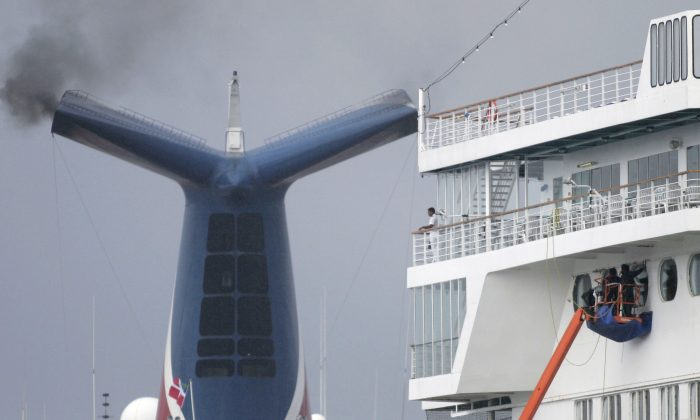 Workmen make repairs to a Carnival cruise ship in the Port of Galveston, Texas.  (Photo by Dave Einsel/Getty Images)