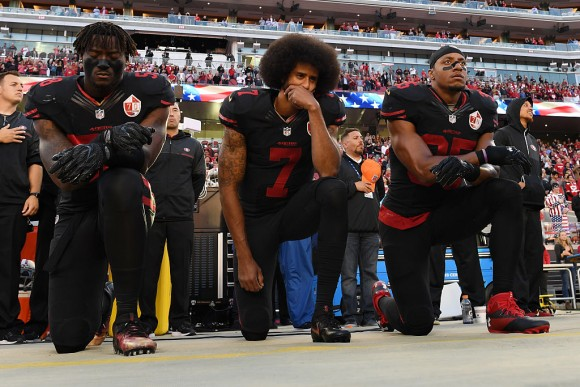 (L-R) Eli Harold #58, Colin Kaepernick #7, and Eric Reid #35 of the San Francisco 49ers kneel in protest during the national anthem prior to their NFL game against the Arizona Cardinals at Levi's Stadium on October 6, 2016 in Santa Clara, California.  (Thearon W. Henderson/Getty Images)