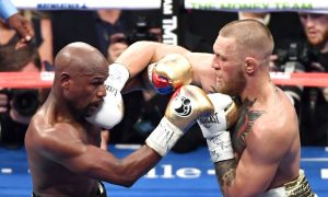 Conor McGregor's Gloves Were Laced Incorrectly in Mayweather Fight, Irish Boxing Champ Says