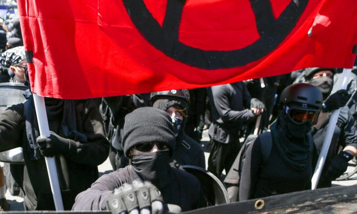 Far left Antifa extremists gather at Martin Luther King Jr. park in Berkeley , California on Aug. 27, 2017. The extremists attacked small groups of pro-Trump and conservative protesters. (AMY OSBORNE/AFP/Getty Images)
