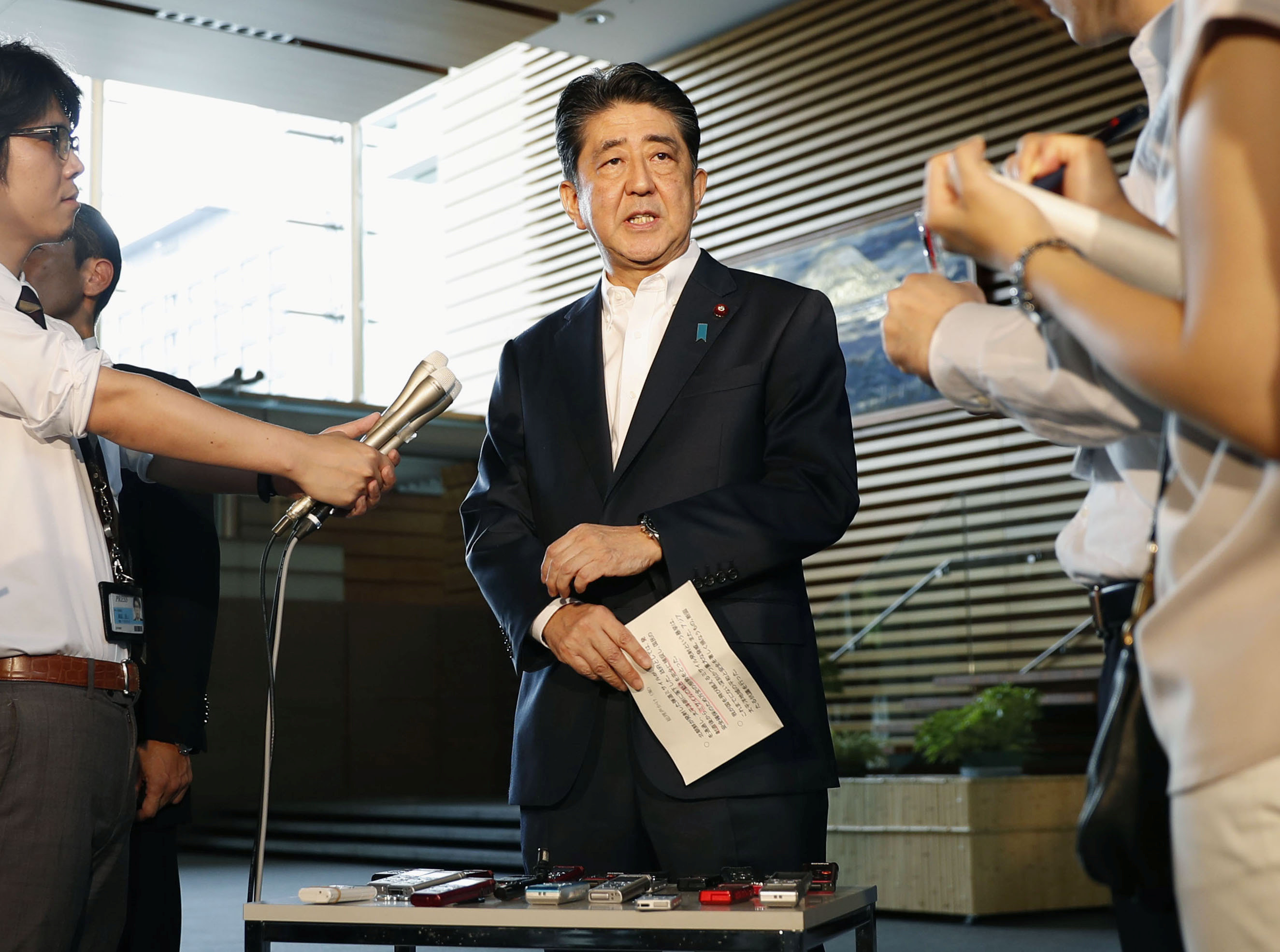 Japanese Prime Minister Shinzo Abe speaks to reporters about North Korea's missile launch in Tokyo, Japan in this photo taken by Kyodo on Aug. 29, 2017. (Kyodo/via REUTERS)