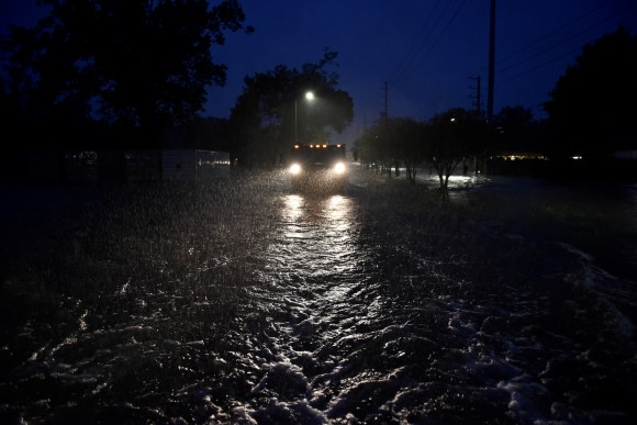 A civilian owned military vehicle drives through floodwaters performing search and rescue after Hurricane Harvey inundated the Texas Gulf coast with rain causing widespread flooding, in Houston, Texas, U.S. August 28, 2017.  (Reuters/Nick Oxford)