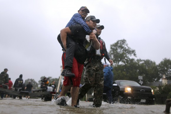 An elderly man is carried after being rescued from the flood waters of tropical storm Harvey in east Houston, Texas, U.S., August 28, 2017. (Reuters/Jonathan Bachman)