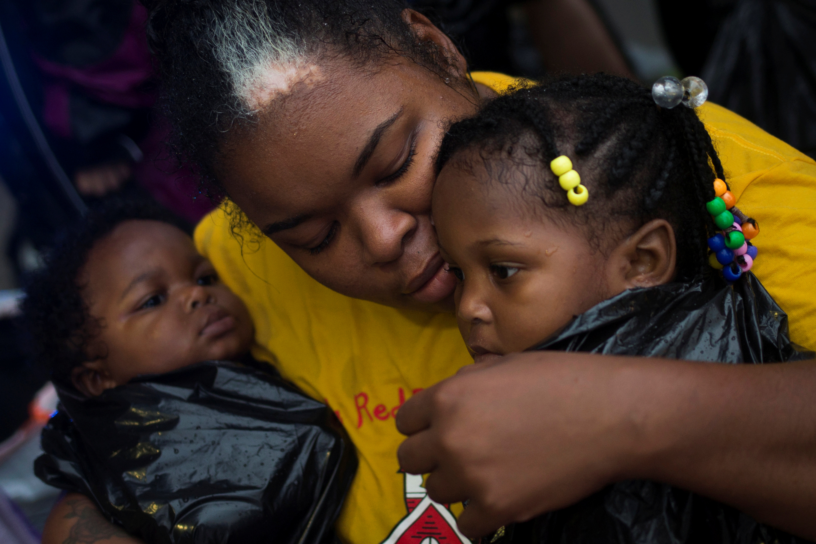 Laquanta Edwards holds her one year old daughter Ladaja (R) and nine-month-old son LaDarius after they arrived to high ground by boat due to floods caused by Tropical Storm Harvey along Tidwell Road in east Houston, Texas, U.S. August 28, 2017. (REUTERS/Adrees Latif)