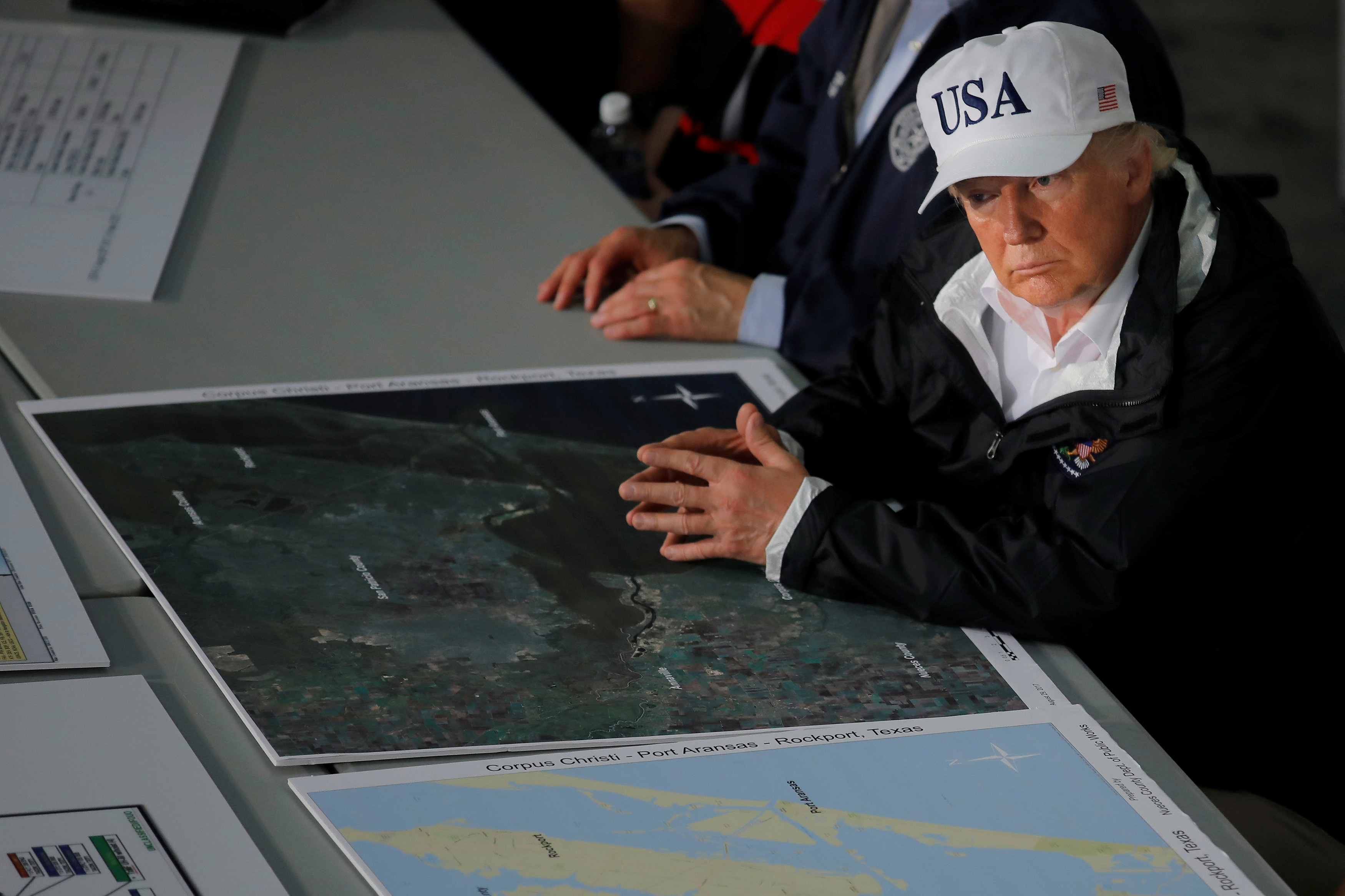 U.S. President Donald Trump receives a briefing on Tropical Storm Harvey relief efforts in Corpus Christi, Texas, U.S., August 29, 2017. (REUTERS/Carlos Barria)