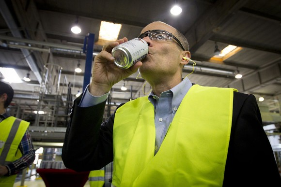Carlos Brito, CEO of brewery group AB Inbev, drinks a can of 'emergency water' during the launch of new 'emergency drinking water cans', which would be made available for people during disasters in Western Europe, in Leuven, on June 5, 2013. (KRISTOF VAN ACCOM/AFP/Getty Images)