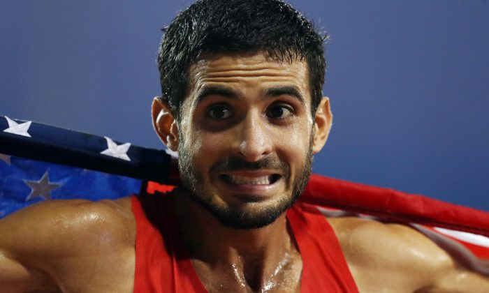David Torrence of the USA celebrates winning Silver in the Men's 5000m Final during Day 15 of the Toronto 2015 Pan Am Games at the Pan Am Athletics Stadium on July 25, 2015 in Toronto, Ontario, Canada. (Vaughn Ridley/Getty Images)