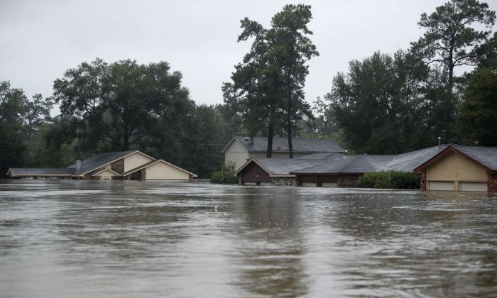 Homes are seen inundated with flooding from Hurricane Harvey on August 28, 2017 in Houston, Texas. Harvey, which made landfall north of Corpus Christi late Friday evening, is expected to dump upwards to 40 inches of rain in Texas over the next couple of days.  (Joe Raedle/Getty Images)