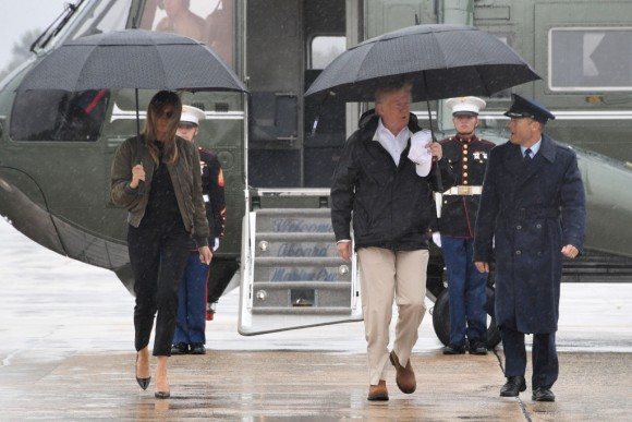 US President Donald Trump and First Lady Melania Trump walk to board Air Force One at Andrews Air Force Base, Maryland, on August 29, 2017 en route to Texas to view the damage caused by Hurricane Harvey. (JIM WATSON/AFP/Getty Images)