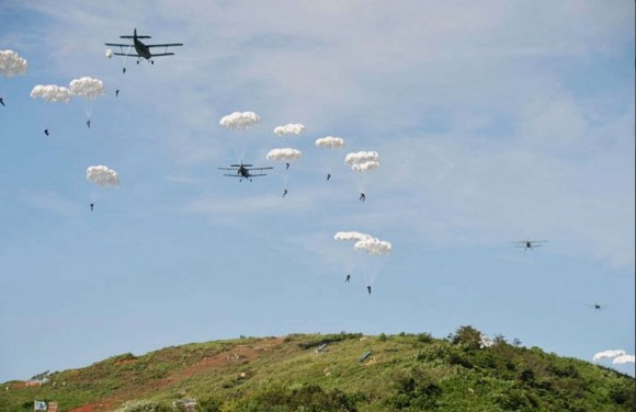 Antonov An-2 airplanes drop paratroopers during a military exercise. (North Korean State Media)