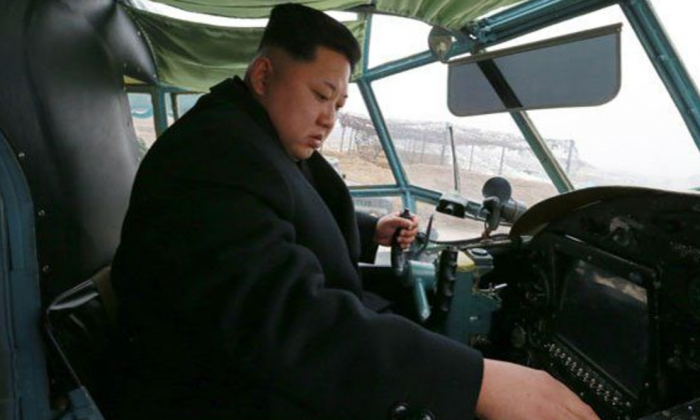 North Korean dictator Kim Jung Un inside an aircraft that can potentially be used as a stealth nuke carrier. (North Korean State Media)