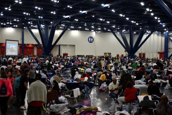 Evacuees fill an exhibition hall at the George R. Brown Convention Center where people have taken refuge in Houston, Texas, U.S. August 29, 2017.  (Reuters/Nick Oxford)
