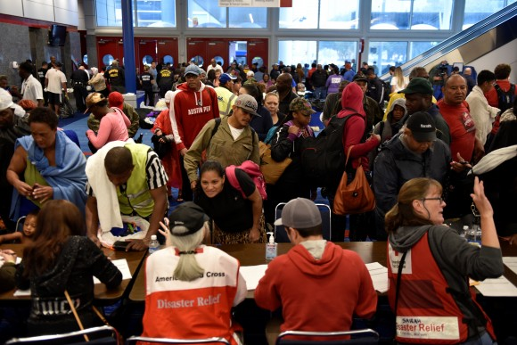 Volunteers with The American Red Cross register evacuees at the George R. Brown Convention Center after Hurricane Harvey inundated the Texas Gulf coast with rain causing widespread flooding, in Houston, Texas, U.S. August 28, 2017.  (Reuters/Nick Oxford)