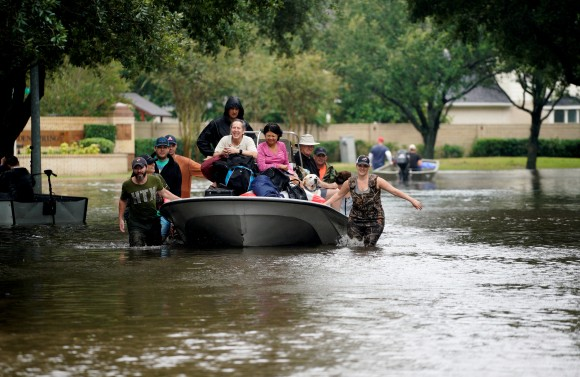 People evacuate by boat from the Hurricane Harvey floodwaters in Houston, Texas August 29, 2017. (Reuters/Rick Wilking)