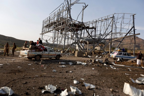 Vehicles carrying travellers pass by a checkpoint of the armed Houthi movement after it was hit by a Saudi-led air strike near Sanaa, Yemen August 30, 2017. (Reuters/Khaled Abdullah)