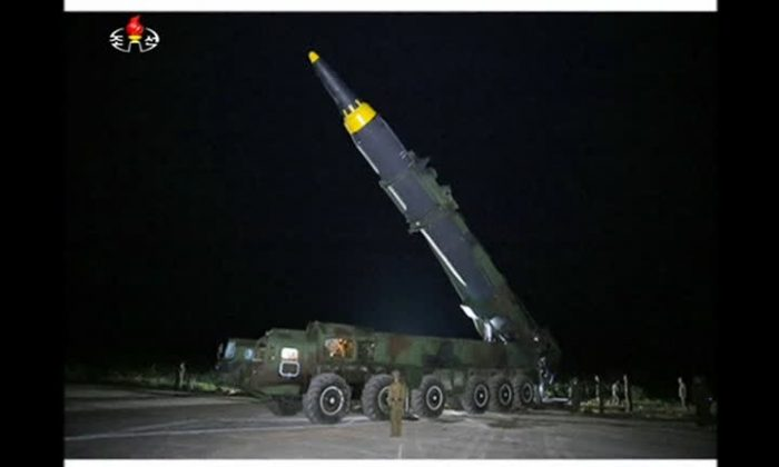 A North Korean intermediate-range ballistic missile Hwasong-12 is shown prior to launch from a vehicle. (screenshot)
