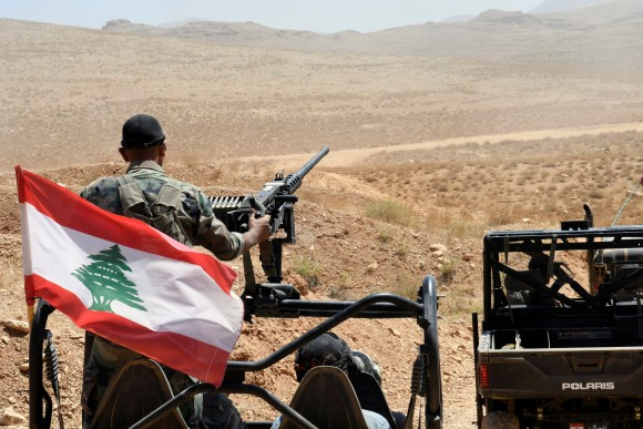 Lebanese Army soldiers ride on their military vehicles in Ras Baalbek, Lebanon August 28, 2017. (Reuters/Hassan Abdallah)