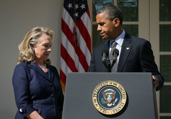 U.S. President Barack Obama (R) makes a statement in response to the attack at the U.S. Consulate in Libya as Secretary of State Hillary Clinton (L) looks on September 12, 2012 at the Rose Garden of the White House in Washington, DC. U.S. Ambassador J. Christopher Stevens and three other Americans were killed in an attack on the U.S. Consulate in Benghazi, Libya by protesters who were potentially angry over a controversial Prophet Muhammad video.  (Alex Wong/Getty Images)